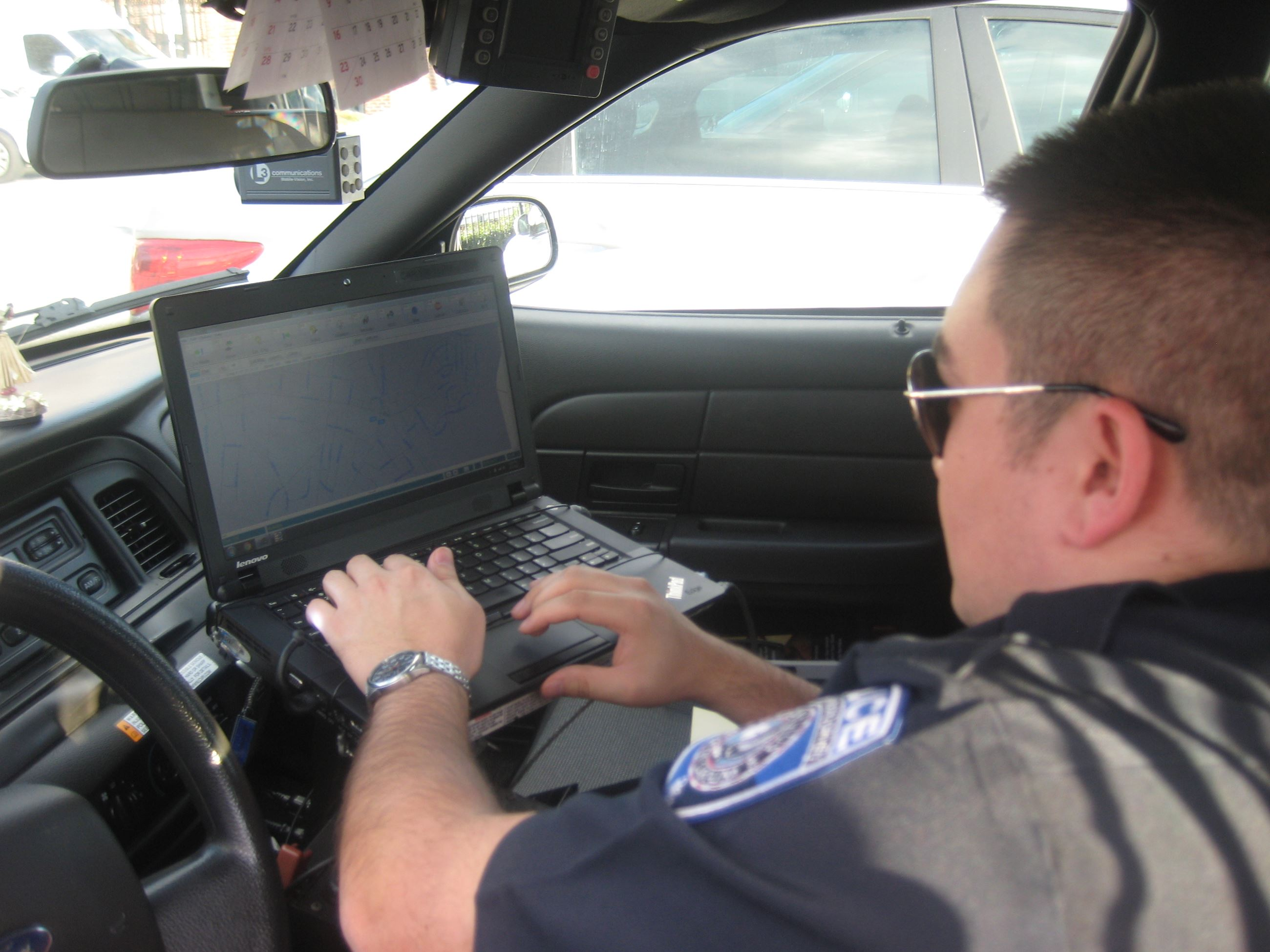 Officer on laptop